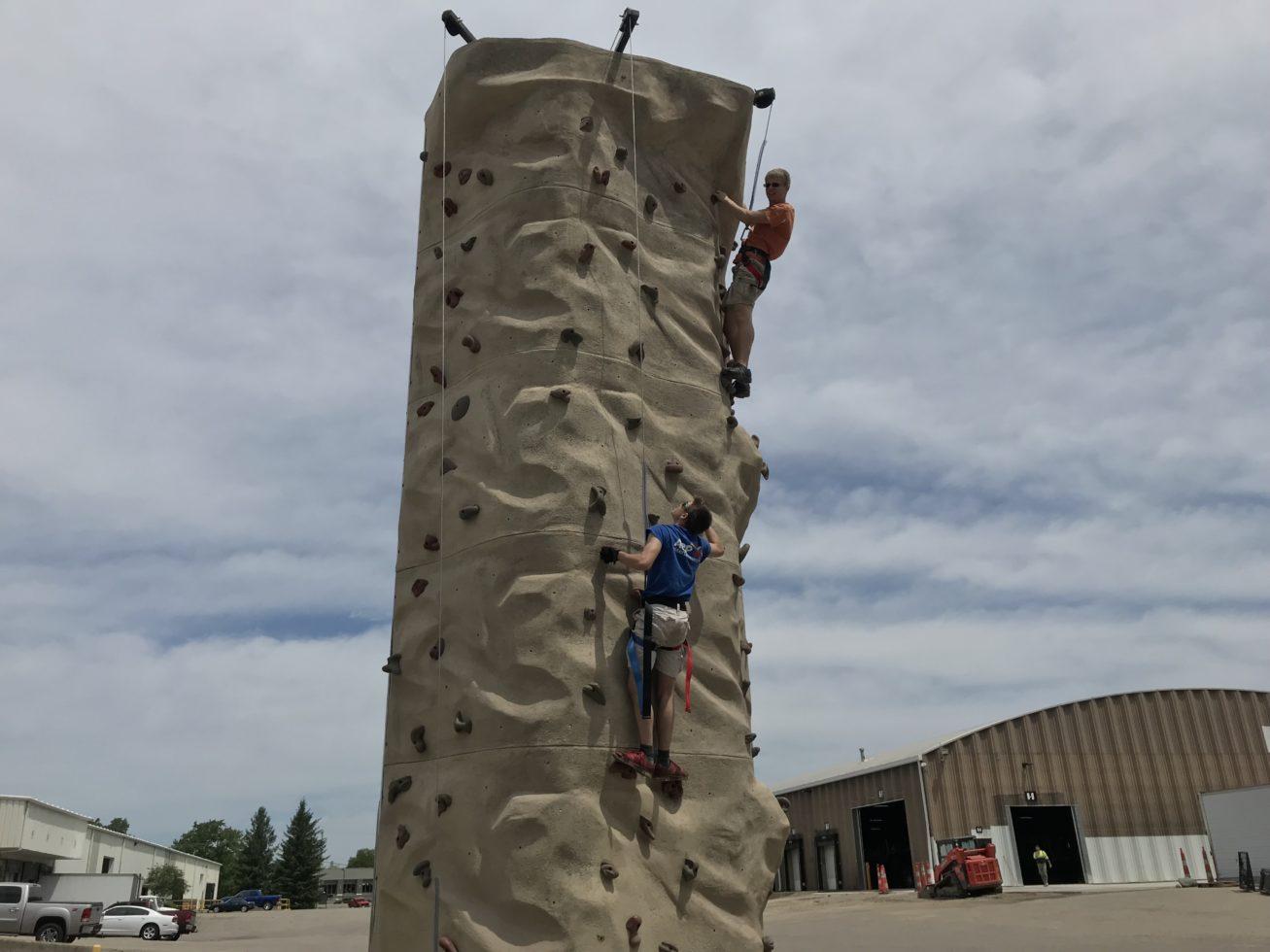 2 guys climbing a rock wall rental Grand Rapids Michigan
