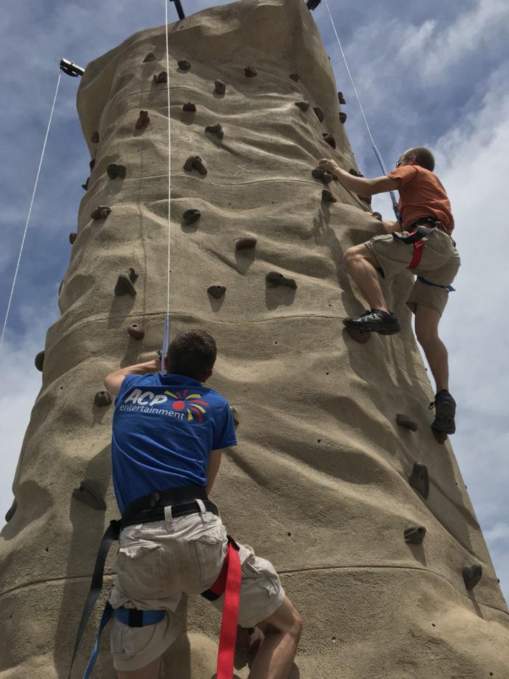 ACP Entertainment staff climbing sahara rock wall