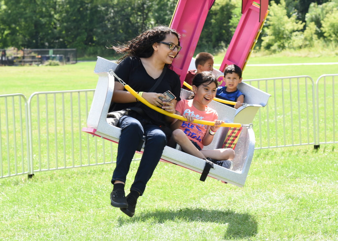 Adult and child on swing