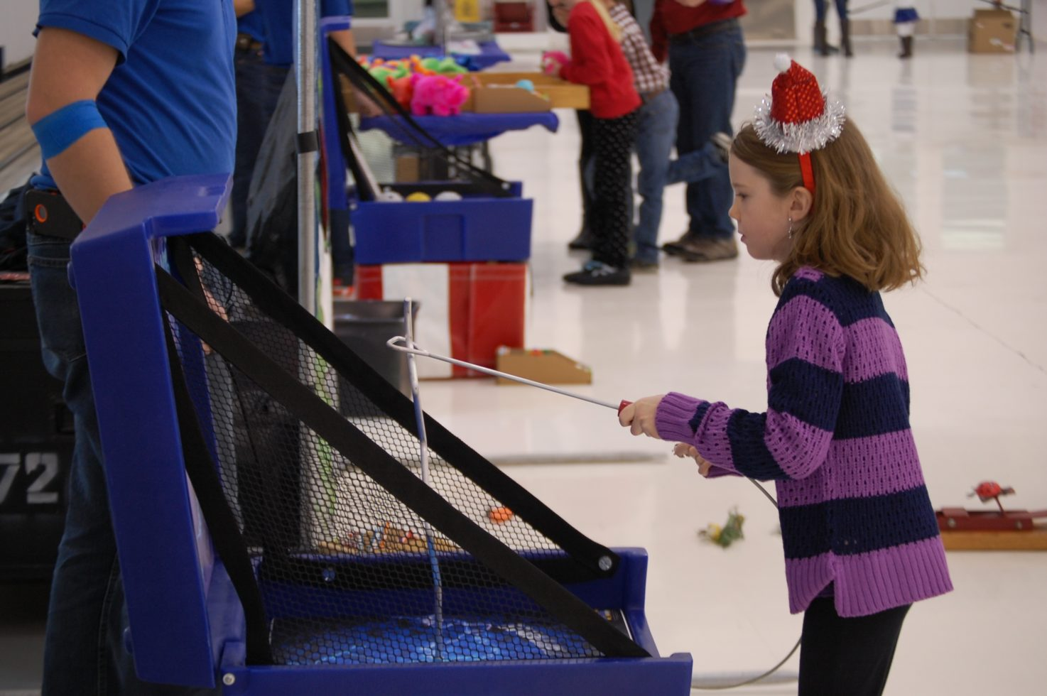 girl playing shockwave carnival game