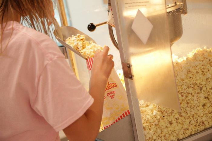 putting popcorn in bag