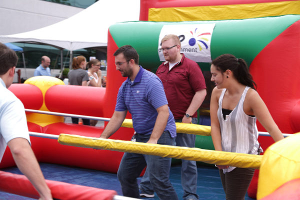 people playing human foosball