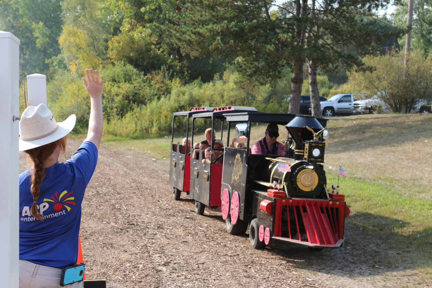 Conductor waiving to kids on train