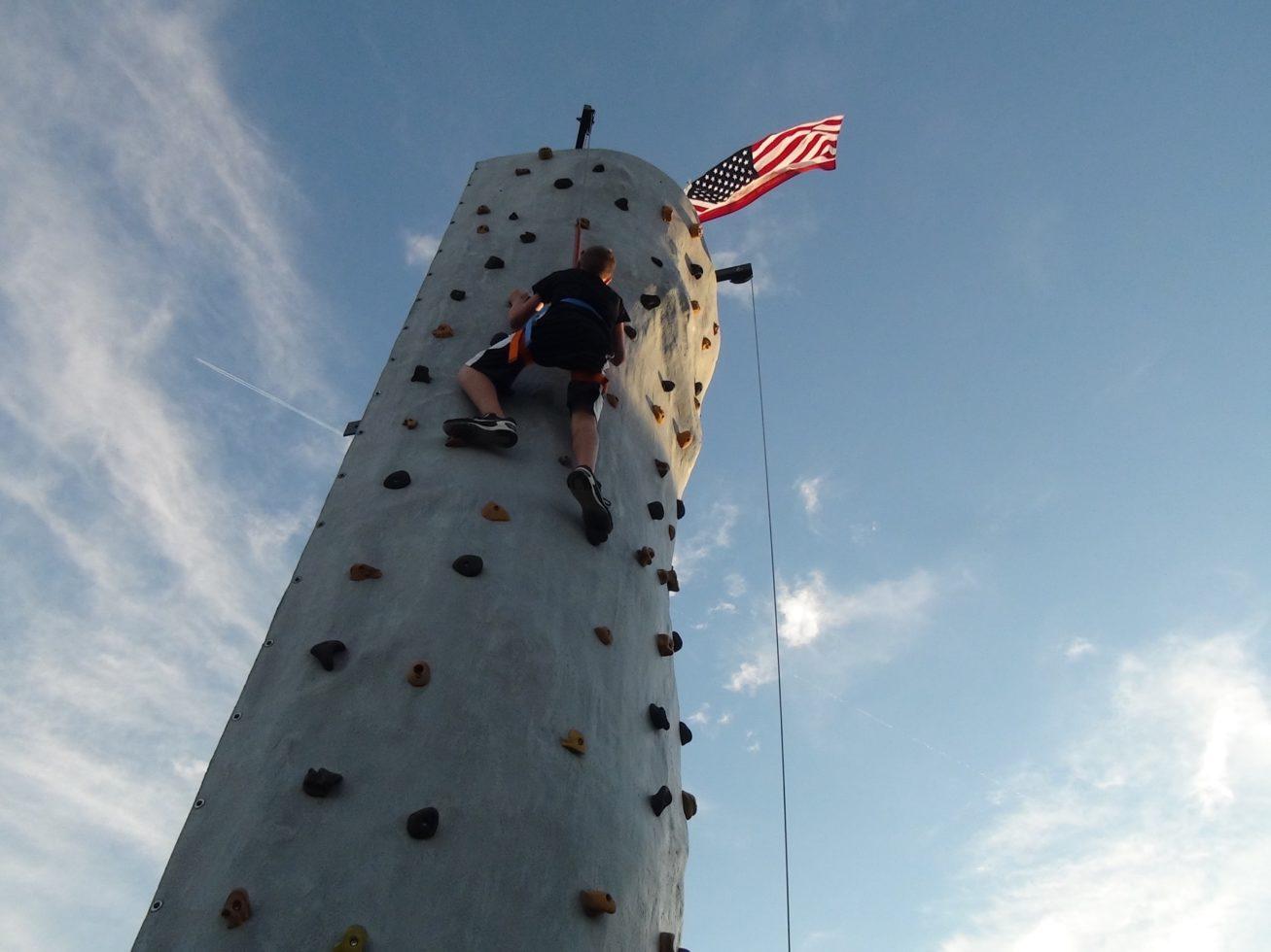 Kid Climbing rock wall