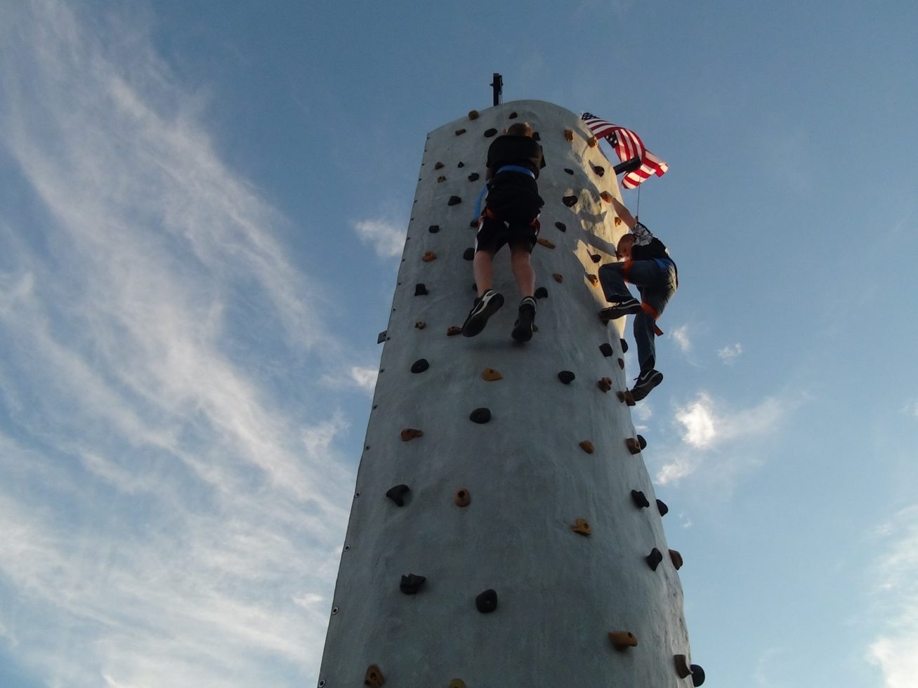 Kids climbing rock wall