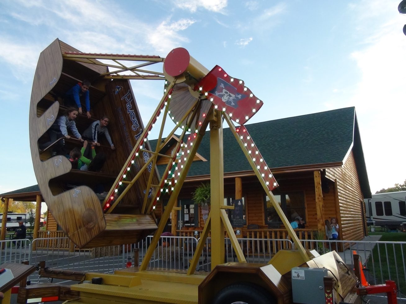 Kids riding on pirates revenge ride