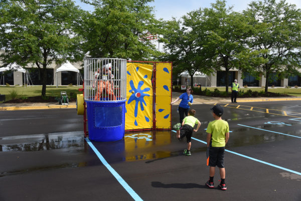 kids throwing ball at dunk tank target