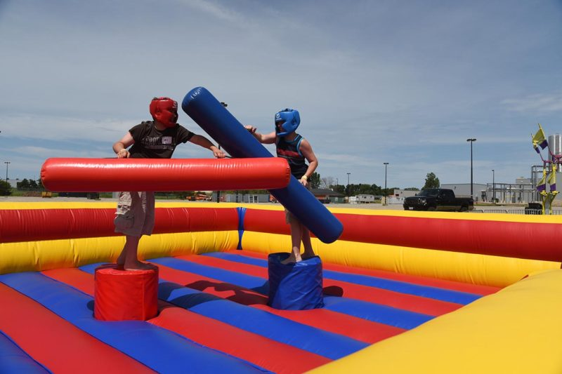 two young boys playing gladiator joust