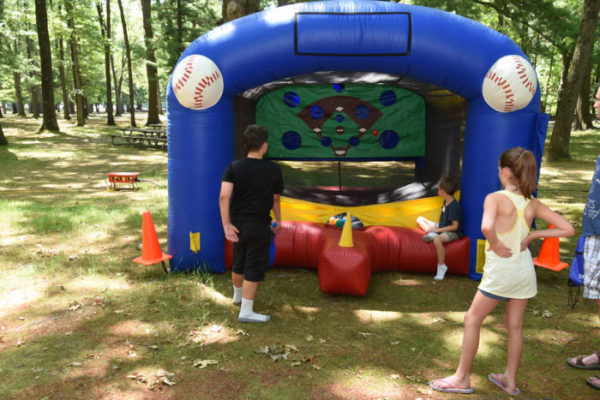 kids playing inflatable t-ball