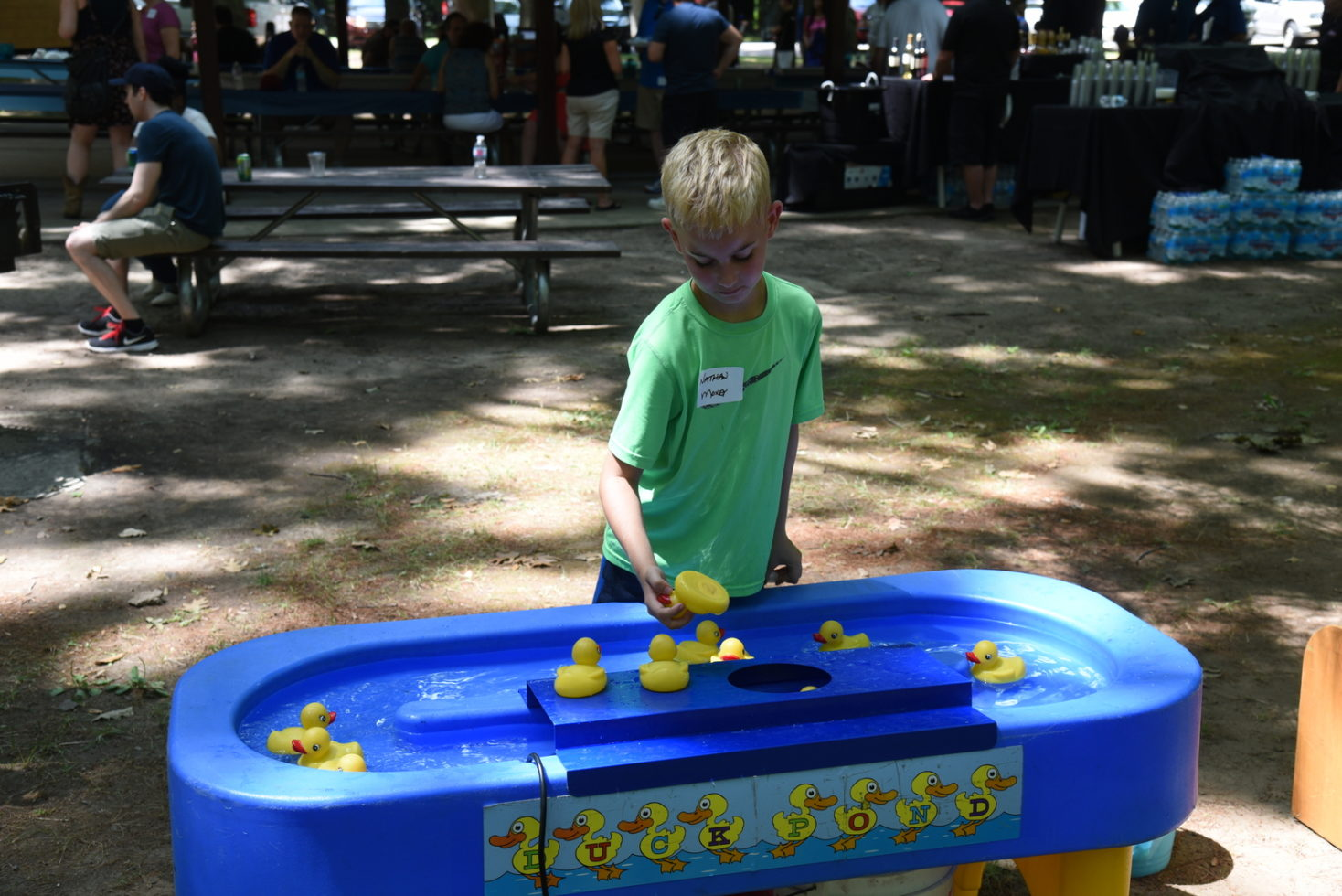 boy playing duck pond game