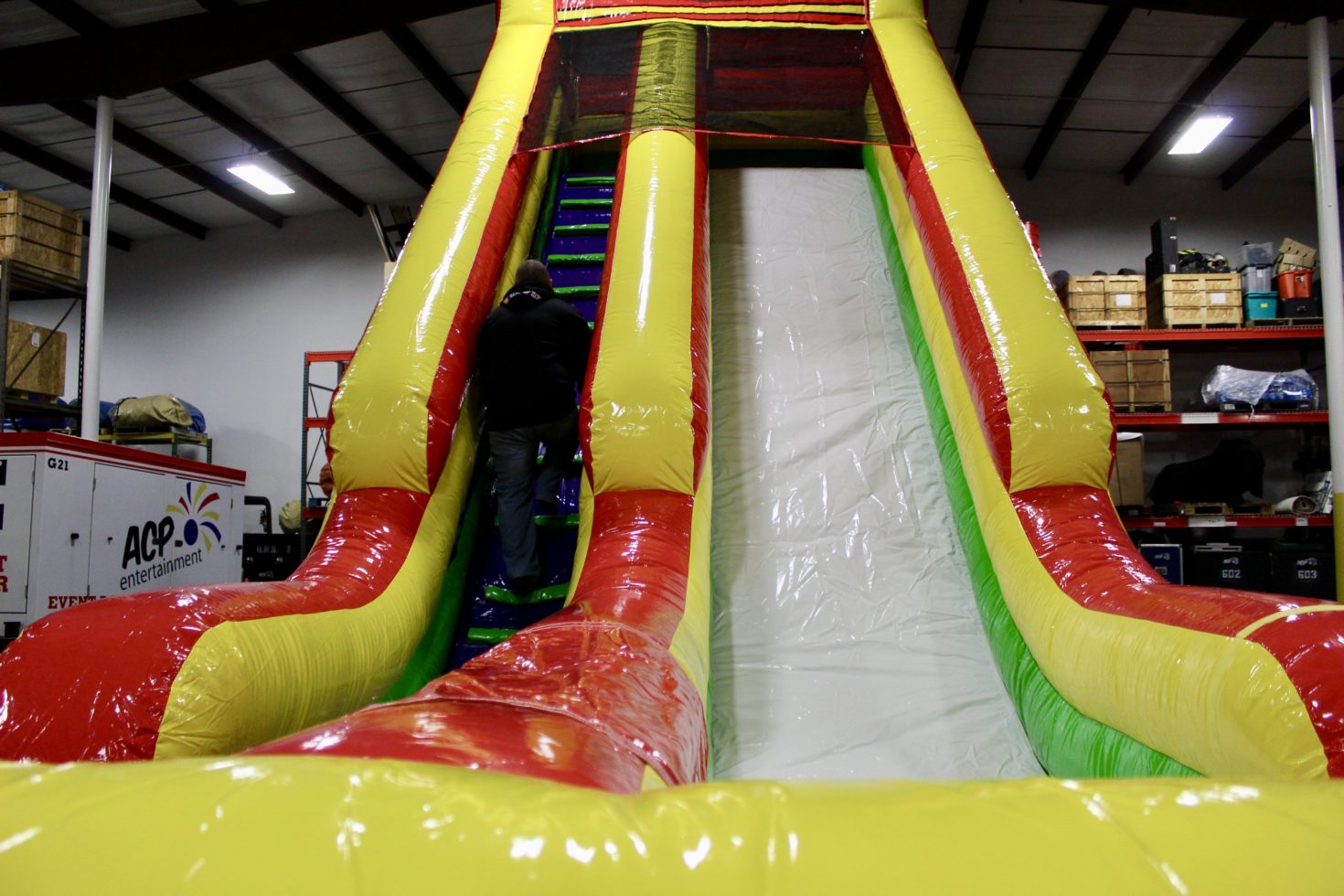 Guy climbing inflatable slide