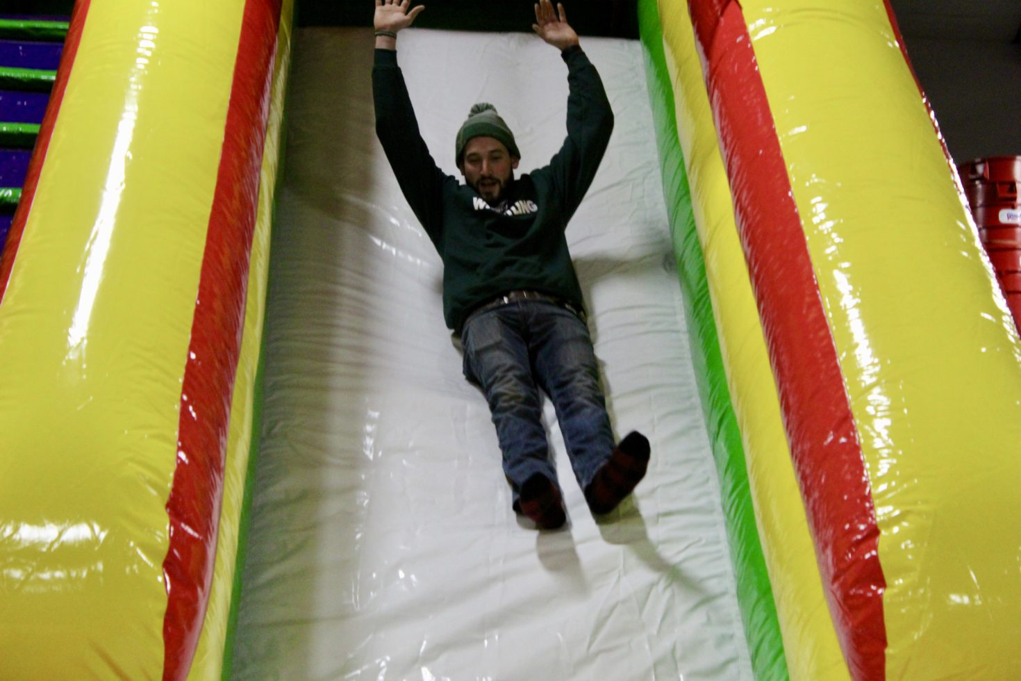 Guy going down inflatable slide rental