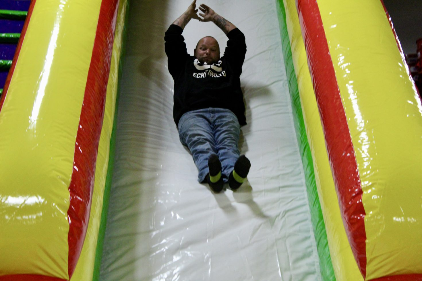 Guy sliding down commander slide