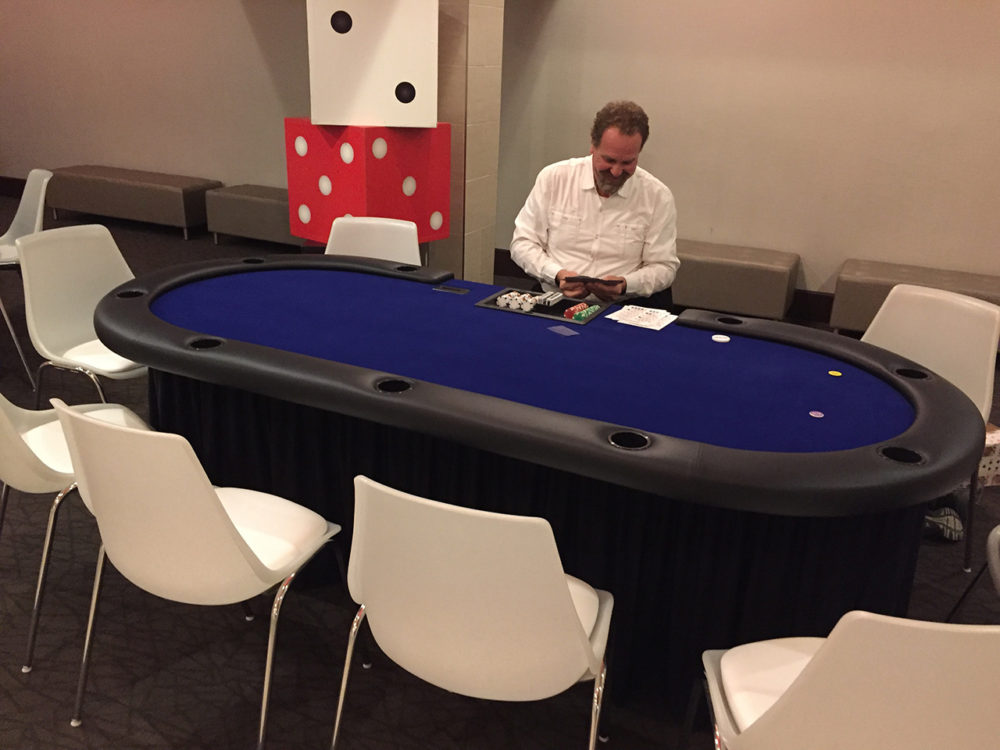 man at poker table