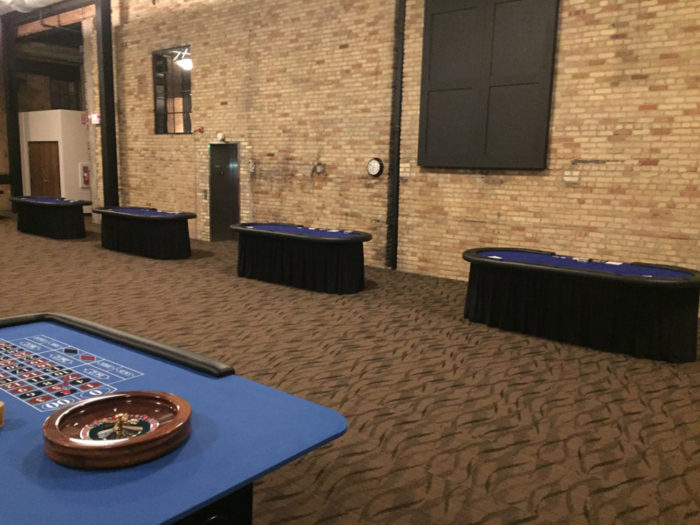 four poker tables set up