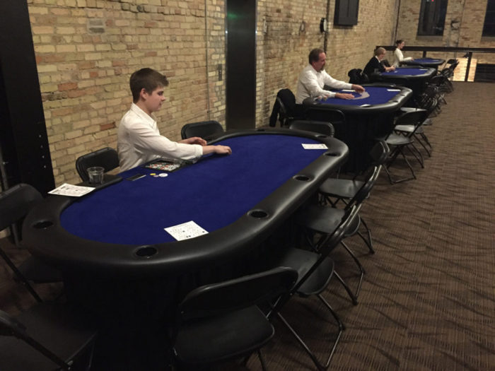 people at poker tables