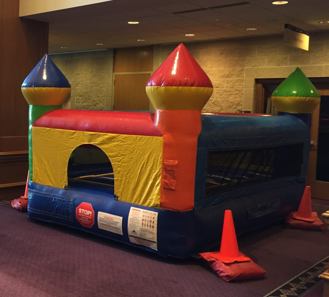 mini bounce inflatable setup inside church
