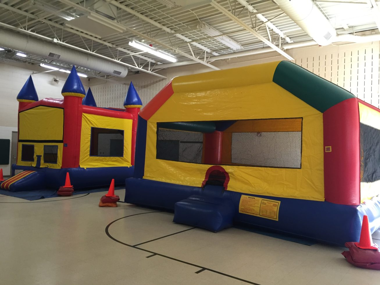 Funhouse and mod castle setup inside gymnasium