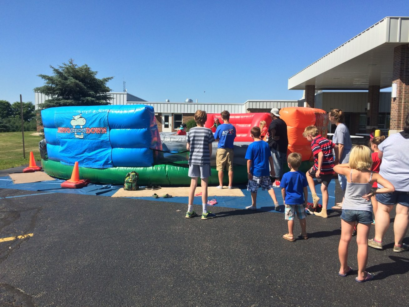 kids lined up for Hippo Chow down inflatable