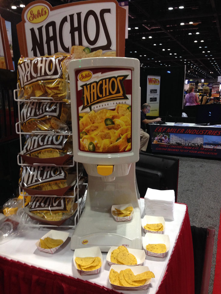 nacho cheese with nacho chips next to it