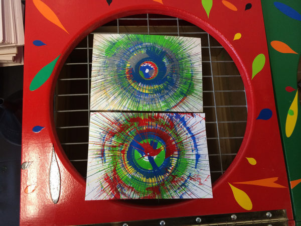 two spin art finished creations on machine