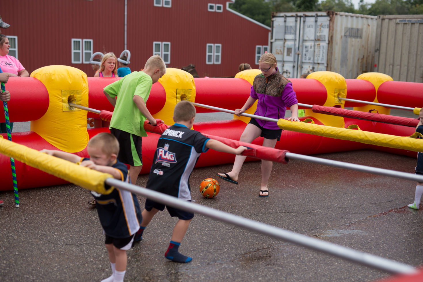 kids playing human foosball game