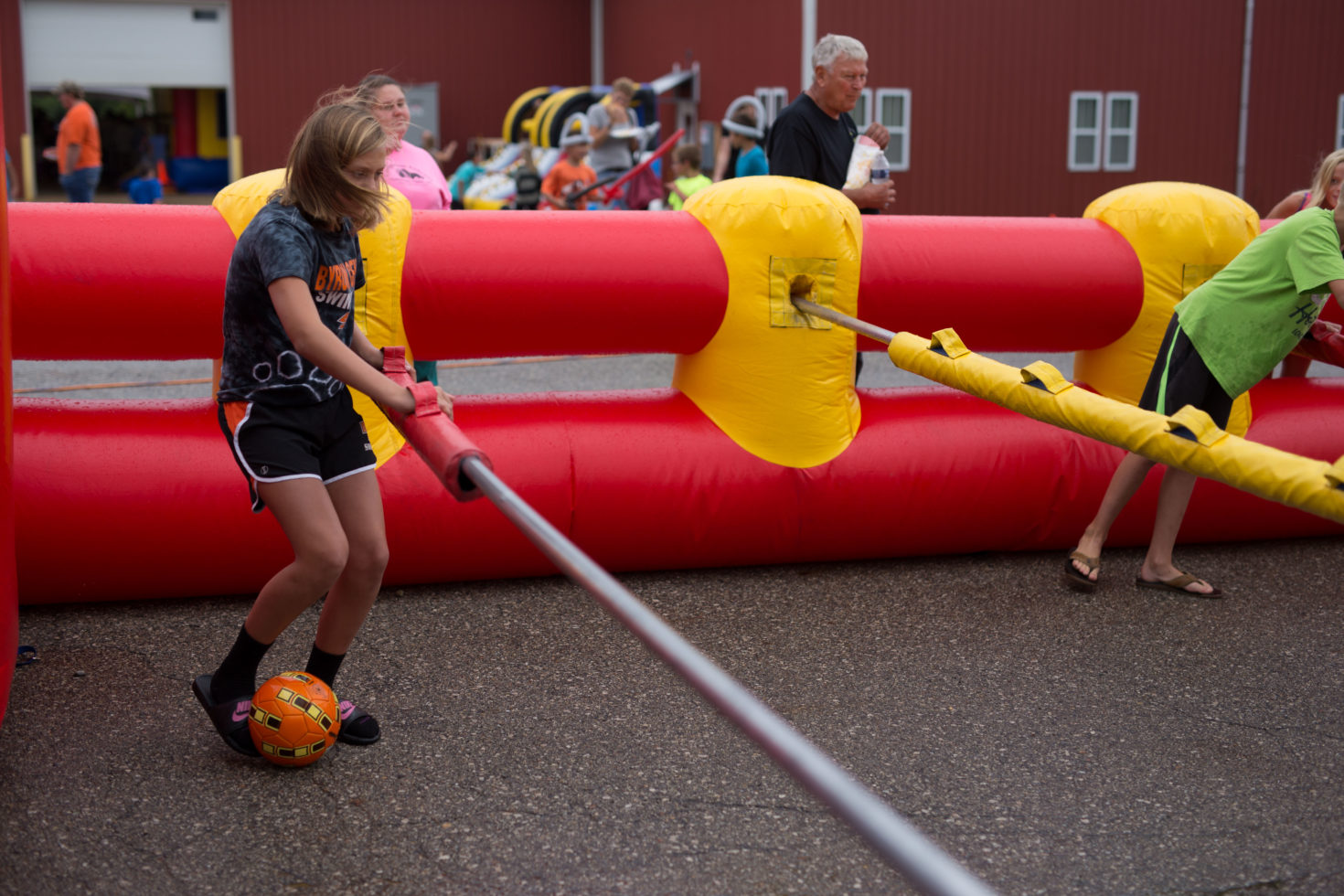girl playing human foosball