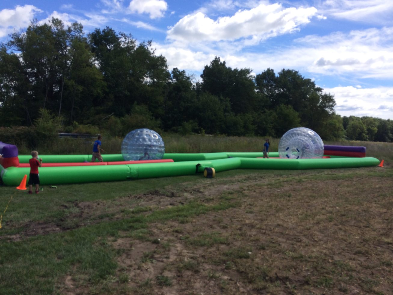 Human hamster balls at event