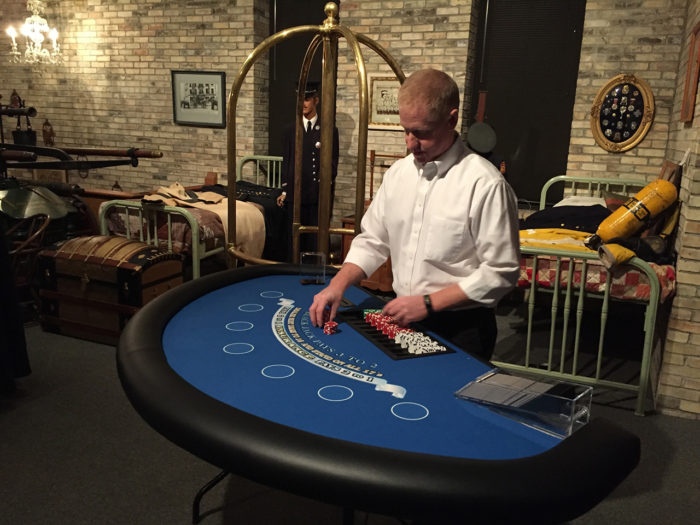 man at black jack table
