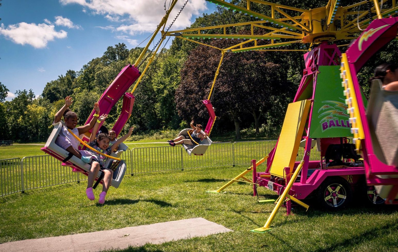 kids on ballistic swing ride