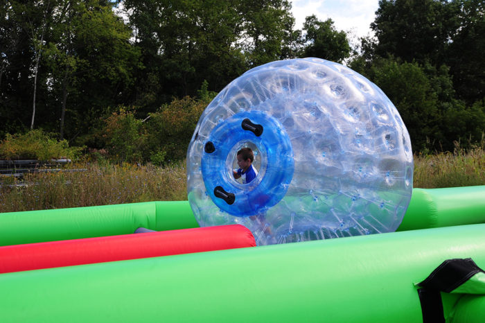 little boy rolling in human hamster ball