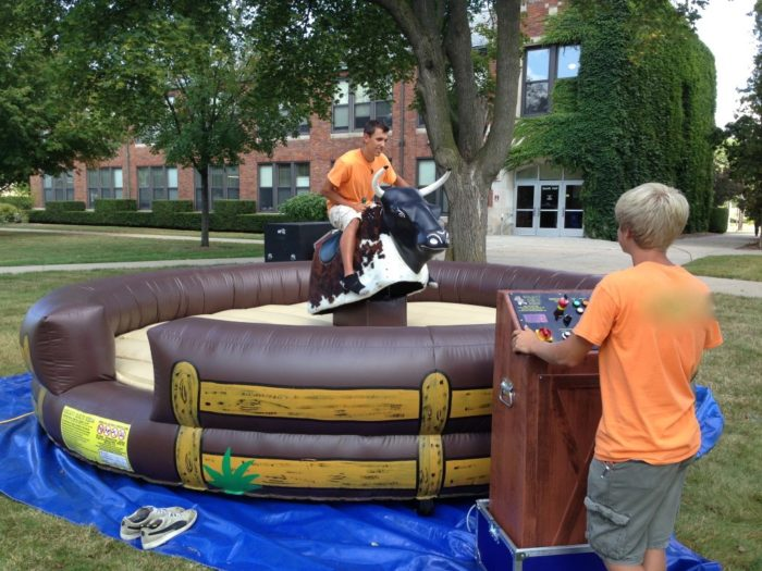 Teenager riding mechanical bull