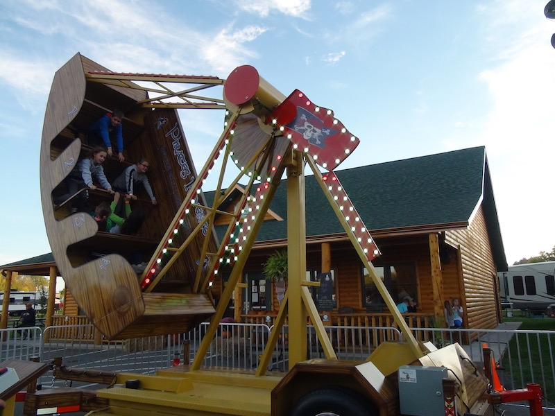 Kids riding on pirate ship ride