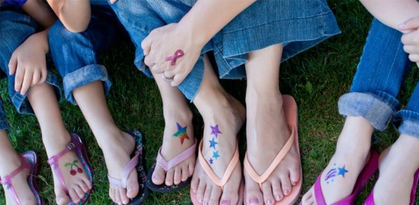 kids with various glitter tattoos on hands and feet