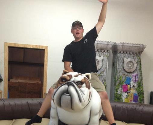 man-riding-mechanical-bulldog
