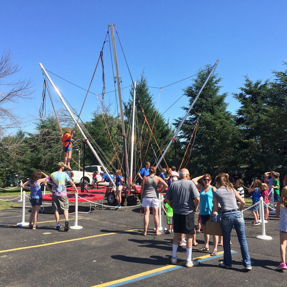 people lined up for bungee trampoline