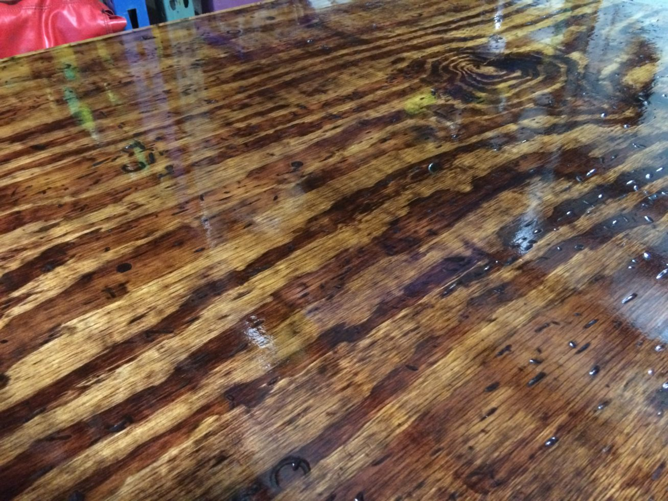 shiny wood grain on rustic poker table