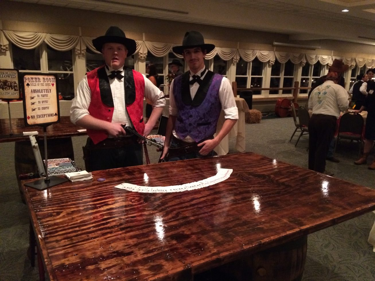 Custom built poker tables with saloon cowboy poker dealers