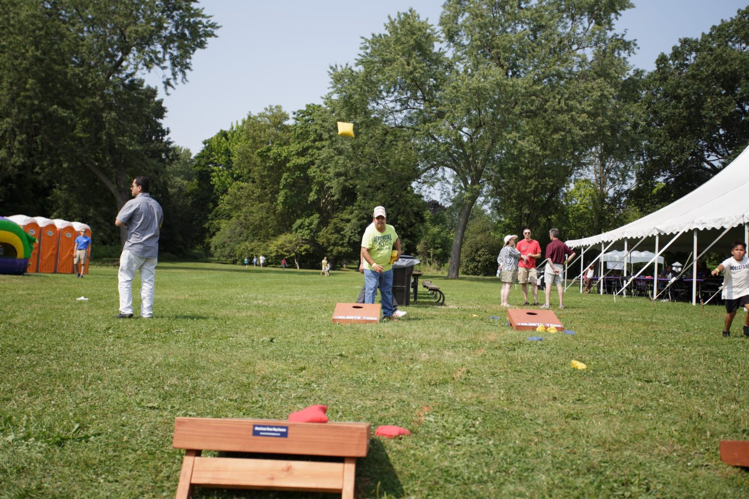 Man playing corn hole game