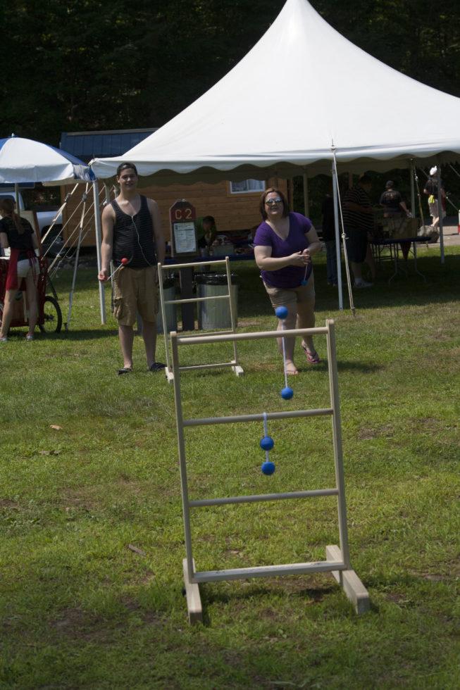 People playing ladder golf game