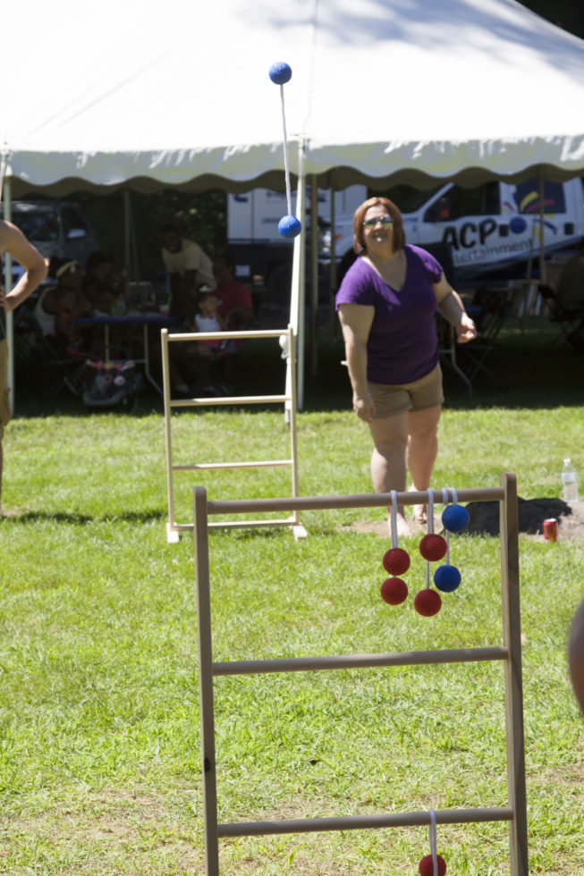 Woman playing ladder golf game