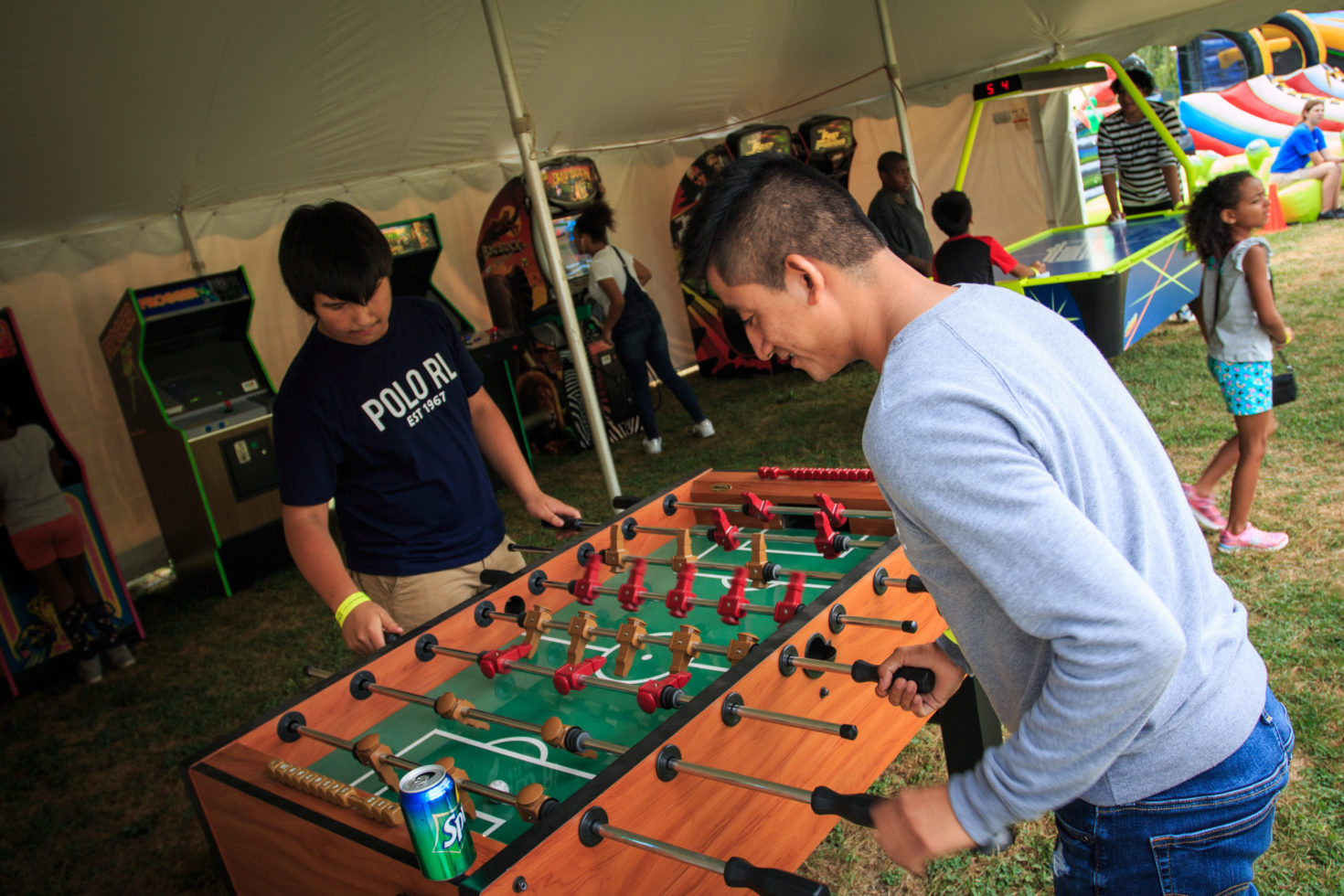 2 guys playing foosball