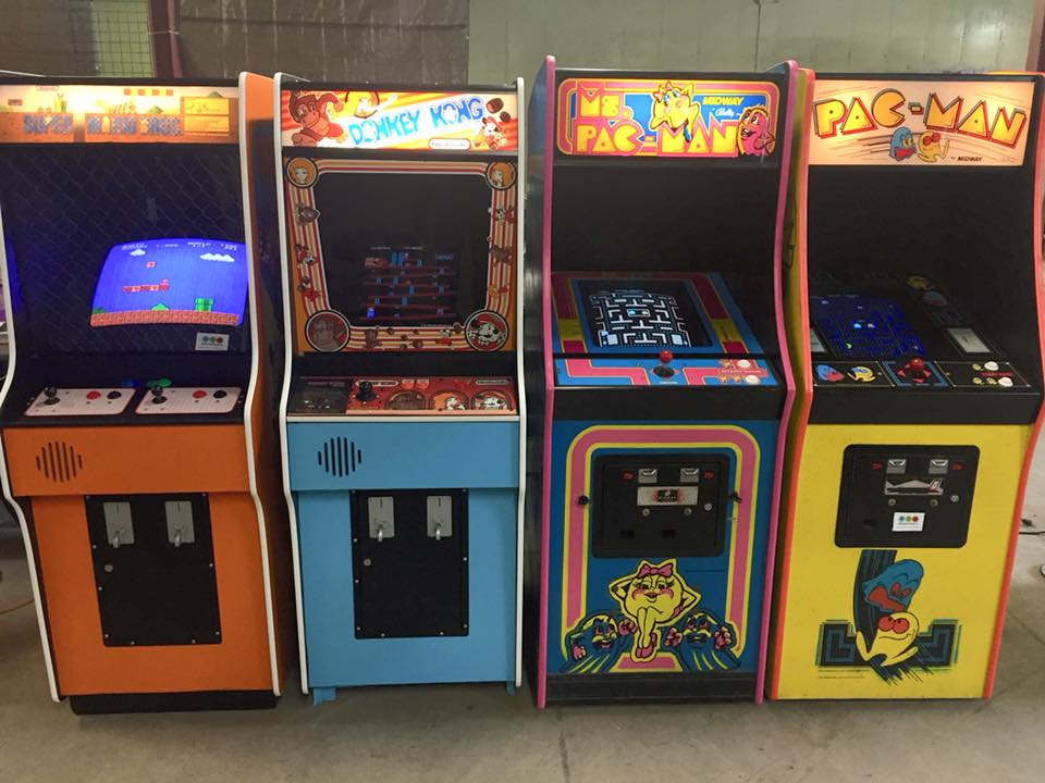 4 arcade games lined up next to each other
