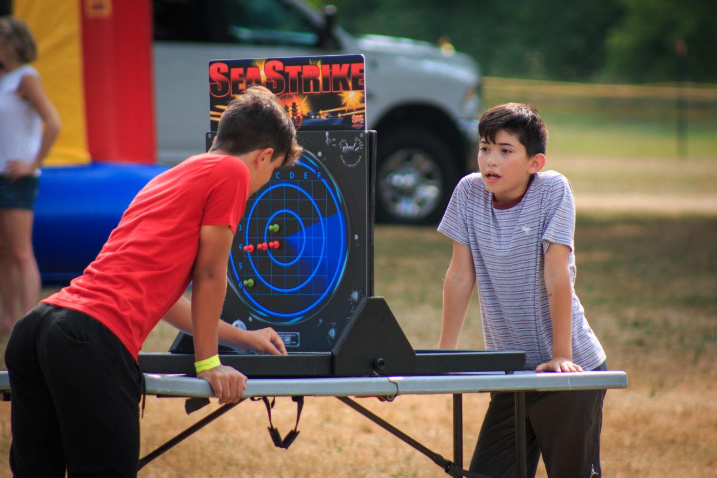2 guys playing giant battleship