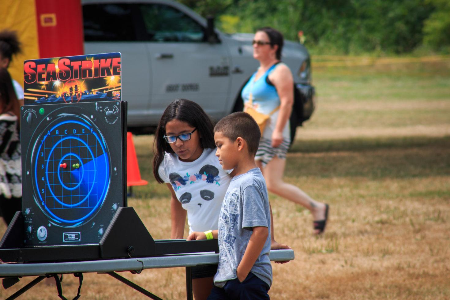 Kids playing giant battleship