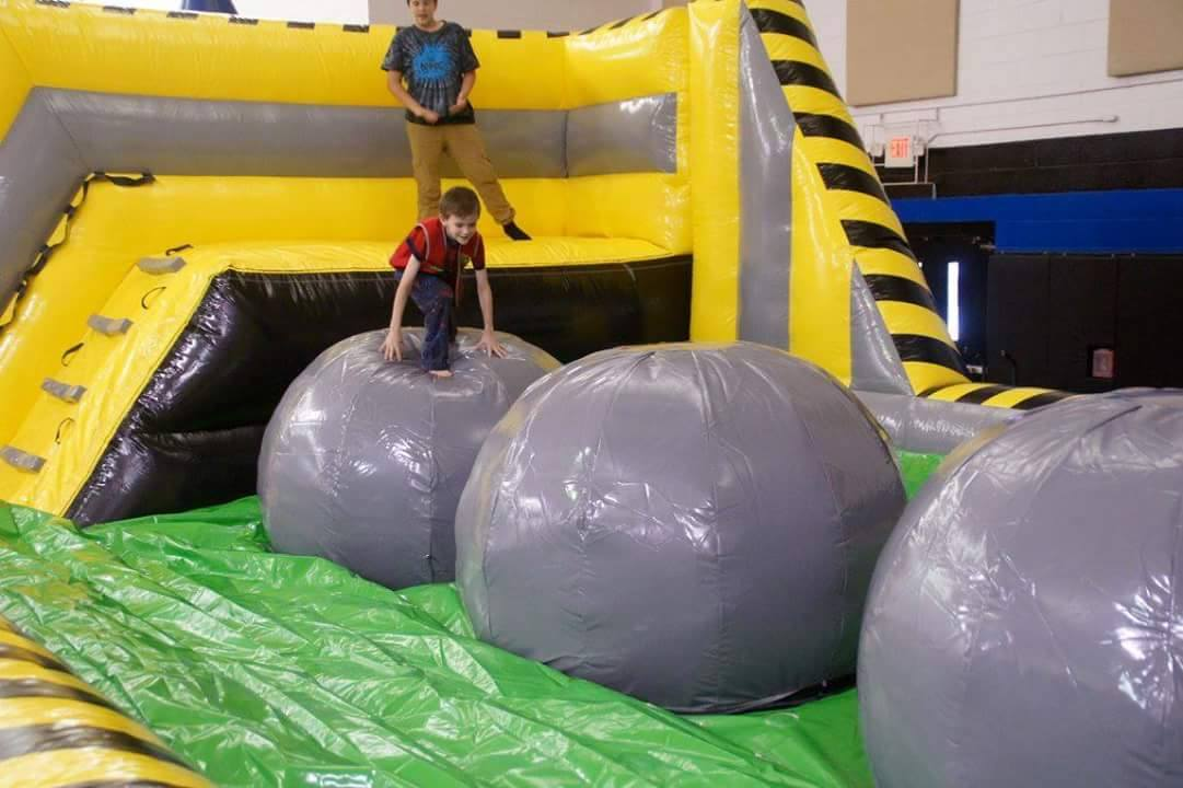 Leaps and Bounds inflatable with kid on it
