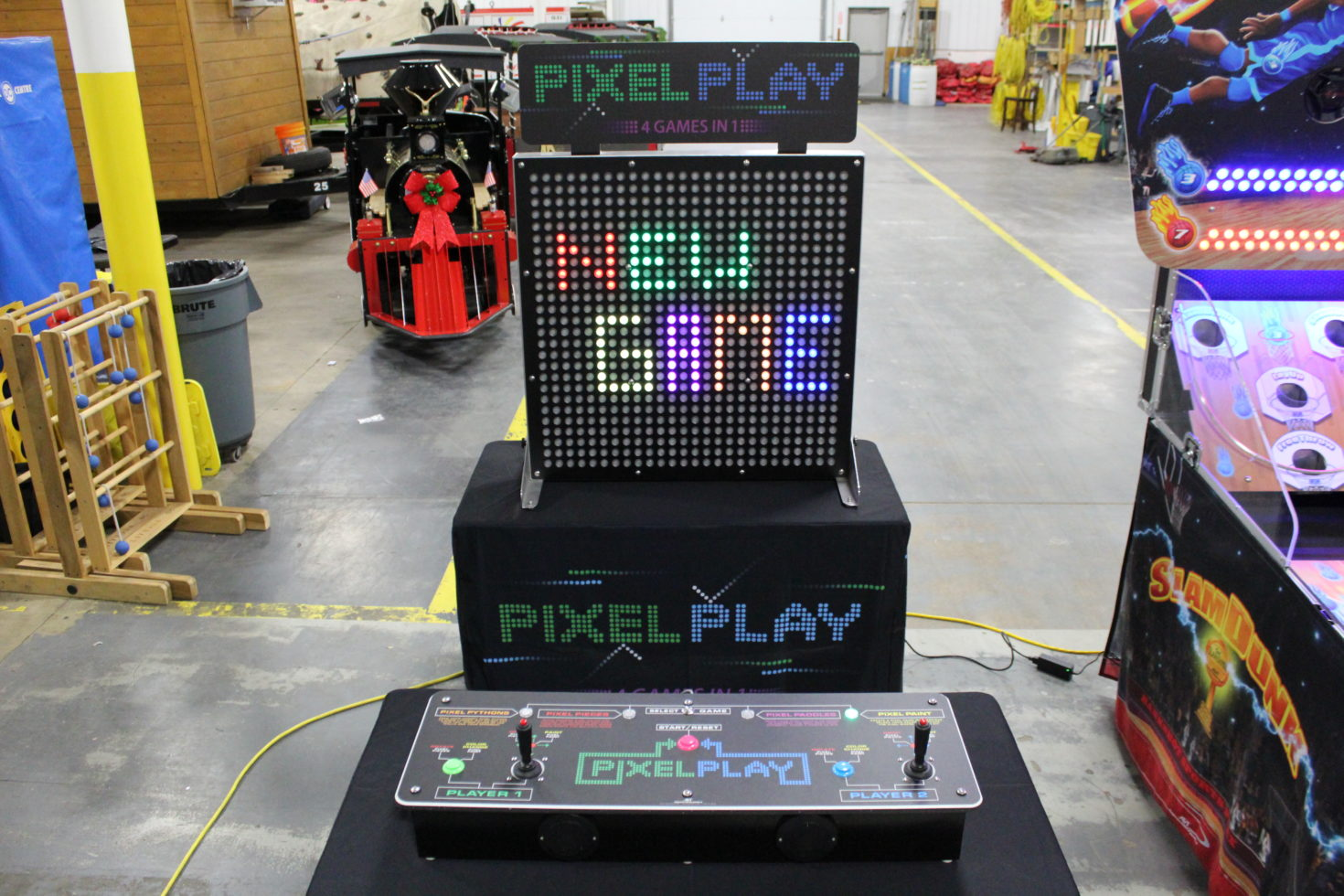 Wide shot of pixel play and control console