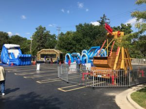 Inflatables and Carnival ride setup in Garden City Michigan Detroit Area