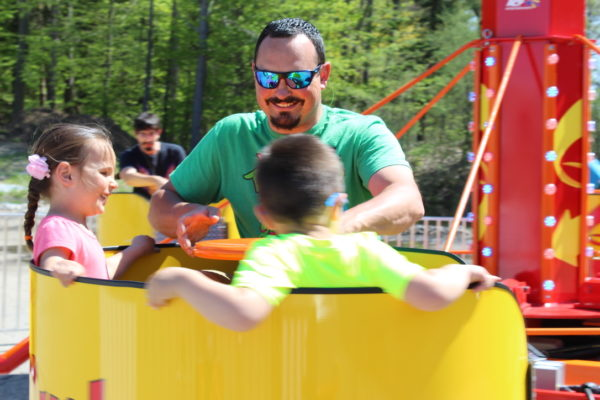Family of three in Spin Cycle Carnival Ride rental