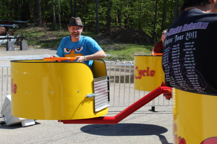 Guy in Spin Cycle Ride spinning tub